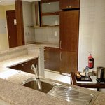 The suite had a full-featured kitchen, including a clothes-washer machine.
