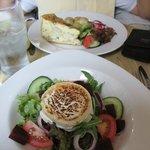 Front plate=toasted goat cheese with beets and greens; rear plate=quiche with haddock