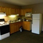 Kitchenette - Spotless appliances. Full-sized fridge and stove.