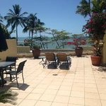 Our private roof terrace overlooking pool and beach with BBQ hut to right