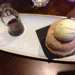 Cinnamon doughnuts with pistachio ice cream and chocolate sauce