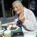 Mum enjoying her fudge cake.
