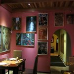 Charming hotel restaurant decorated with photographs of Venice, Italy