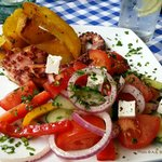 Grilled octopus, Greek potatoes and salad
