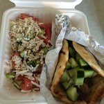 Lamb  souvlaki in a pita with greek salad