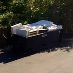View from room- a dumpster on Hampton inn property with disposed mattresses, remained there for
