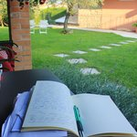 Taking a journalling break in the adorable backyard