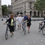 Pushing the bikes in Parliament square