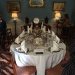 The Dining room with all the fine silverware to show the extravagance of the quality of the hous