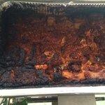 Burnt lasagna on the brunch buffet.