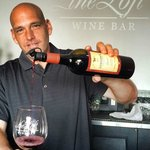 Jason Diavatis, Owner of The Loft Wine Bar in Benicia serving behind the bar