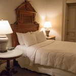 Queen bed with door to balcony