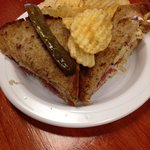 To die for Rueben sandwich, which is grilled on the artisan rye bread with homemade sauerkraut!