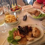 Our Meals. Tuna steak and grilled seafood and fish platter