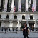 our tour guide in front of the NY Stock Exchange