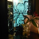 Decorative mirror in booth adjacent to the bar
