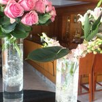 Beautiful fresh flowers in reception and piano bar