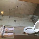Bathroom with no shower door. Water pressure is excellent, plenty hot water.