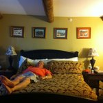 My husband taking a little break on the oh so divinely comfy bed!