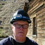 Elderly tourist with helmet