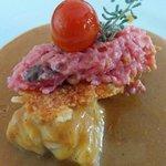 rape en salsa americana con rissoto rosa con crujiente de queso de mahon y cherry confitado