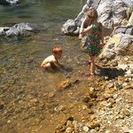 kids playing in the clear water