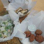 Veggie wrap, Caesar salad and falafal with tzatziki.