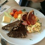 Herb omelette with brown bread and organic bacon