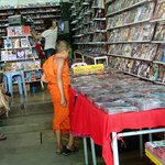 A young monk shopping for movies