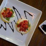 Seared Polenta appetizer with fresh basil, mozzarella, roaster red pepper and balsamic reduction