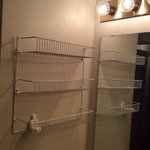 Note the dated fixtures and wire basket shelving in bath.  Very skimpy on amenities!