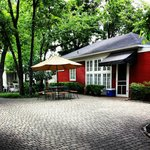 The Red Cottage. Beautiful cobblestone pavers everywhere!