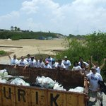 DI Lend-A-Hand team collaborating in the 20th Aruba Reef Care Beach Cleanup Project!