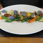 Fresh vegetables with scallops seared with poppy seeds