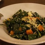 kale salad with bits of chorizo, corn bread croutons and São Jorge cheese