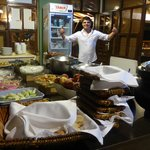 A sample buffet of the abundant diverse delicious food and chef