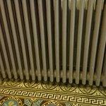 Mass of dust and broken tiles in the bedroom