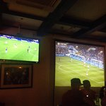 A lot of TV screens with football. All leagues! A lot of drinks ! Fish&Chips is ok ! Taxi is a f