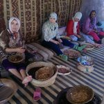 Cosmetics company women getting the argan nuts sorted