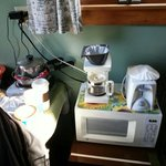 "The ""kitchenette"". To use coffe pot you have to unplug the frig."