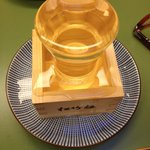 Sake, which was filled with three glasses and plates