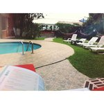 sitting by the pool reading lonely planet