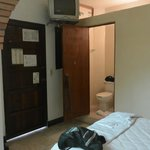 Single bedroom w/TV in ceiling toward bathroom