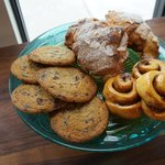 Breakfast treats: cookies, chocolate almond croissants, and cinnamon buns.