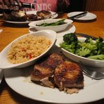 Pork chops with rice pilaf and steamed broccoli