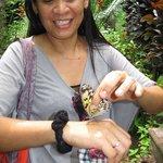 my wife with one of the butterflies....