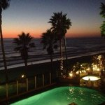 The tail end of a beautful sunset and the pool area at night! Beautiful!