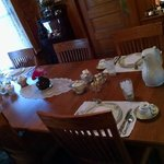Breakfast table set for four