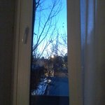 O dia veio se encostar na janela