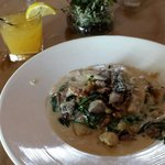 Butternut squash gnocchi, kale and duck topped wirh walnuts and cream sauce
